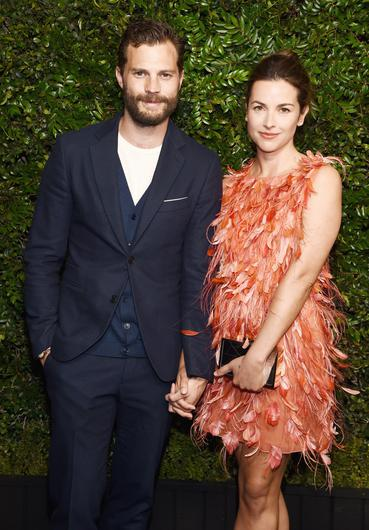 SONG STRESS: Jamie Dornan with wife Amelia Warner