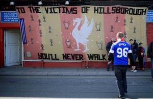 LIVERPOOL, ENGLAND - APRIL 15:  An Everton fan arrives in Anfield for a memorial service marking the 25th anniversary of the Hillsborough Disaster at Anfield stadium on April 15, 2014 in Liverpool, England. Thousands of fans, friends and relatives are attending the service at Liverpool's Anfield stadium to mark the 25th anniversary of the Hillsborough disaster. Bells across the City of Liverpool will ring during a one minute silence. A total of 96 Liverpool supporters lost their lives during a crush at an FA Cup semi final against Nottingham Forest at the Hillsborough football ground in Sheffield, South Yorkshire in 1989.  (Photo by Christopher Furlong/Getty Images)