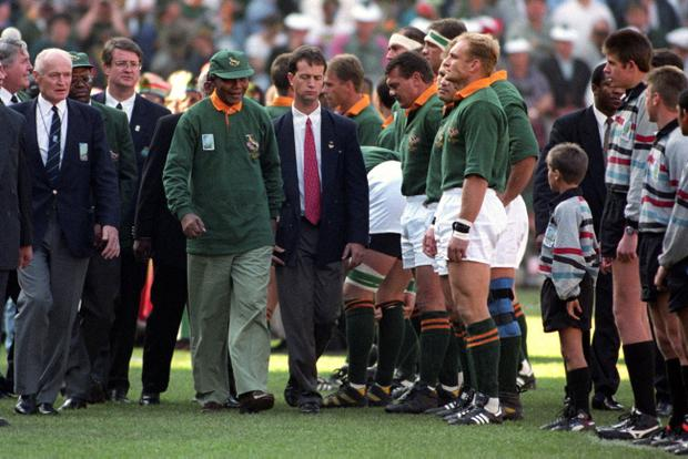 File photo dated 24/06/1995 of Nelson Mandela walking past Francois Pienaar in the line up before the Rugby World Cup Final in Johannesburg's Ellis Park. Former South African leader Nelson Mandela has died at the age of 95, the country's president, Jacob Zuma, said tonight. PRESS ASSOCIATION Photo. Issue date: Thursday December 5, 2013. See PA story DEATH Mandela. Photo credit should read John Stillwell/PA Wire