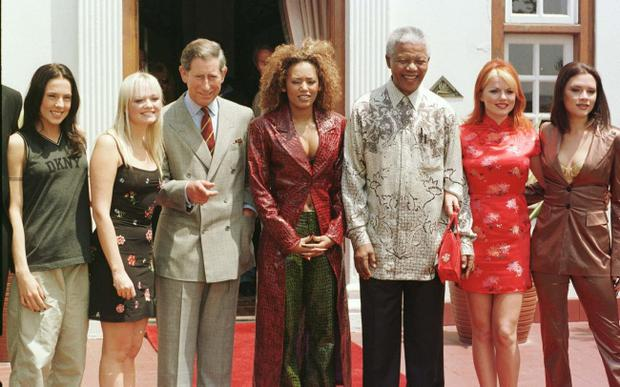 File photo dated 01/11/1997 of the Prince of Wales (left) and South African President Nelson Mandela at a photocall with the Spice Girls (left to right), Mel C, Emma, Mel B, Geri and Victoria at the presidential residence Mahlamba Nalopfu in Pretoria, South Africa. Former South African leader Nelson Mandela has died at the age of 95, the country's president, Jacob Zuma, said tonight. PRESS ASSOCIATION Photo. Issue date: Thursday December 5, 2013. See PA story DEATH Mandela. Photo credit should read John Stillwell/PA Wire