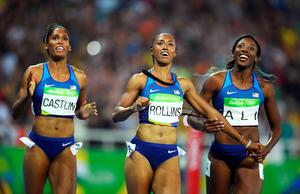 RIO DE JANEIRO, BRAZIL - AUGUST 17:  (L-R) Bronze medalist Kristi Castlin, gold medalist Brianna Rollins and silver medalist Nia Ali of the United States react after the Women's 100m Hurdles Final on Day 12 of the Rio 2016 Olympic Games at the Olympic Stadium on August 17, 2016 in Rio de Janeiro, Brazil.  (Photo by Matthias Hangst/Getty Images)
