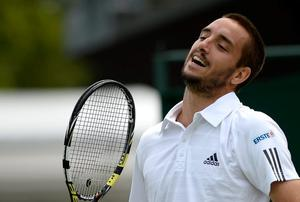 LONDON, ENGLAND - JUNE 26:  Viktor Troicki of Serbia reacts during his Gentlemen's Singles second round match against Andrey Kuznetsov of Russia on day three of the Wimbledon Lawn Tennis Championships at the All England Lawn Tennis and Croquet Club on June 26, 2013 in London, England.  (Photo by Dennis Grombkowski/Getty Images)