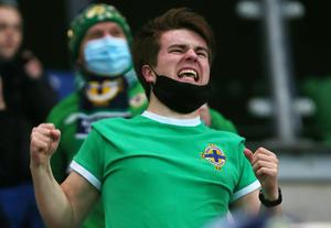 Press Eye - Belfast - Northern Ireland - 12th November 2020  European Championship 2020.  Playoff for Final Tournament - Northern Ireland Vs Slovakia at The National Stadium at Windsor Park, Belfast.  Northern Ireland fans celebrate after they score to make it 1-1.   Picture by Jonathan Porter/PressEye