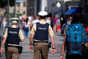 Policemen patrol through a pedestrian area in Munich, southern Germany, on July 23, 2016, one day after the attack at the shopping centre in Munich. Police were probing the motives of the lone teenage German-Iranian gunman who went on a deadly rampage at a busy Munich shopping centre, the third bloody attack on civilians in Europe in just over a week. Nine people were killed and another 16 wounded as the black-clad gunman brought terror to Germany's third largest city on Friday evening, July 22, 2016, before committing suicide. / AFP PHOTO / dpa / Daniel Karmann / Germany OUTDANIEL KARMANN/AFP/Getty Images