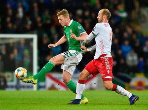 BELFAST, NORTHERN IRELAND - MARCH 24:  George Saville of Northern Ireland holds off Ivan Maevski of Belarus during the 2020 UEFA European Championships Group C qualifying match between Northern Ireland and Belarus at Windsor Park on March 24, 2019 in Belfast, United Kingdom. (Photo by Charles McQuillan/Getty Images)