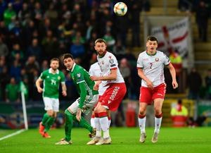 BELFAST, NORTHERN IRELAND - MARCH 24:  Kyle Lafferty of Northern Ireland and Mikhail Sivakov and Stanislav Dragun of Belarus watch the ball during the 2020 UEFA European Championships Group C qualifying match between Northern Ireland and Belarus at Windsor Park on March 24, 2019 in Belfast, United Kingdom. (Photo by Charles McQuillan/Getty Images)