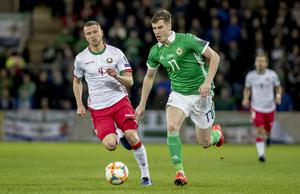 Northern Ireland's Paddy McNair and Belarus Igor Shitov  in action during the European Qualifier at Windsor Park in Belfast on March 24th 2019  (Photo by Kevin Scott for Belfast Telegraph)