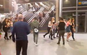 BEST QUALITY AVAILABLE  Picture taken with permission from the twitter feed of @Zach_bruce of people running through Manchester Victoria  station after an explosion at Manchester Arena. PRESS ASSOCIATION Photo. Issue date: Tuesday May 23, 2017. See PA story POLICE Explosion. Photo credit should read: @Zach_bruce/PA Wire  NOTE TO EDITORS: This handout photo may only be used in for editorial reporting purposes for the contemporaneous illustration of events, things or the people in the image or facts mentioned in the caption. Reuse of the picture may require further permission from the copyright holder.