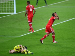 Bayern Munich's Dante (right) after a foul on Borussia Dortmund's Marco Reus, resulting in a penalty during the UEFA Champions League Final at Wembley Stadium, London. PRESS ASSOCIATION Photo. Picture date: Saturday May 25, 2013.