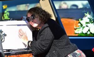 Geraldine (wife and mother) during the funeral of John, Tomas and Amelia Mullan  at St Pius X Parish Church in Moville on Monday. Pic Colm Lenaghan/Pacemaker