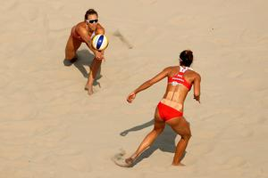 RIO DE JANEIRO, BRAZIL - AUGUST 09:  Monika Brzostek of Poland bumbs the ball during the Women's Beach Volleyball Preliminary Pool A match against Ekaterina Birlova and Evgenia Ukolova of Russia on Day 4 of the Rio 2016 Olympic Games at the Beach Volleyball Arena on August 9, 2016 in Rio de Janeiro, Brazil.  (Photo by Ezra Shaw/Getty Images)