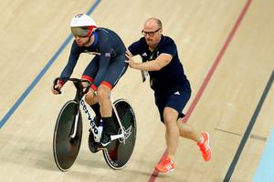 RIO DE JANEIRO, BRAZIL - AUGUST 09:  Mark Cavendish of Great Britain and Team GB gets a push up the track from coach Jan van Eijden during training at the Rio Olympic Velodrome on August 9, 2016 in Rio de Janeiro, Brazil.  (Photo by Bryn Lennon/Getty Images)