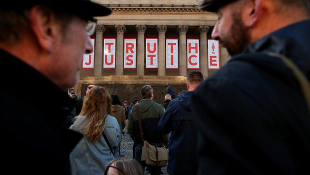 Thousands of people gather outside Liverpool's Saint George's Hall as they attend a vigil for the 96 victims of the Hillsborough tragedy on April 27, 2016 in Liverpool, England.   (Photo by Christopher Furlong/Getty Images)