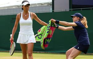 LONDON, ENGLAND - JUNE 26:  Su-Wei Hsieh of Taipei passes her towel to a ballgirl during her Ladies' Singles second round match against Alize Cornet of France on day three of the Wimbledon Lawn Tennis Championships at the All England Lawn Tennis and Croquet Club on June 26, 2013 in London, England.  (Photo by Julian Finney/Getty Images)