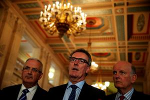 Ulster Unionist Party leader Mike Nesbitt (centre) alongside Danny Kennedy (left) and Michael McGimmpsey (right) speaking to the media at Stormont, Belfast.  Wednesday August 9, 2015.