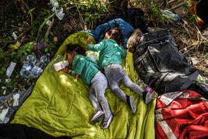 TOPSHOTS Children of refugees sleep at the Hungarian border with Serbia near the town of Horgos on September 16, 2015. Europe's 20-year passport-free Schengen zone appeared to be a risk of crumbling with Germany boosting border controls on parts of its frontier with France as migrants desperate to find a way around Hungary's border fence began crossing into Croatia. With a string of EU countries tightened frontier controls in the face of the unprecedented human influx, the cherished principle of free movement across borders -- a pillar of the European project -- seemed in grave jeopardy. AFP PHOTO / ARMEND NIMANIARMEND NIMANI/AFP/Getty Images