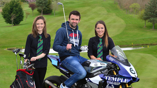 Driving force: William Dunlop aboard the Temple Golf Club Yamaha R1M Superbike, with Rachel Martin and TGC Events Manager Toni Martin, daughters of Temple Golf Club owners Tim and Sonya Martin