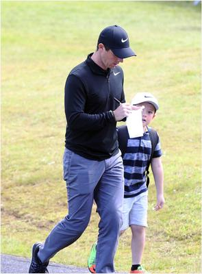 PACEMAKER BELFAST  05/07/2017 Wednesday is the PRO AM at the Dubai Duty Free Irish Open at Portstewart Golf Club. Rory McIlroy signs an autograph for one excited young fan