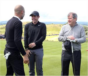 PACEMAKER BELFAST  05/07/2017 Wednesday is the PRO AM at the Dubai Duty Free Irish Open at Portstewart Golf Club. Rory McIlroy on the first tee with Pep Guardiola, JP McManus.