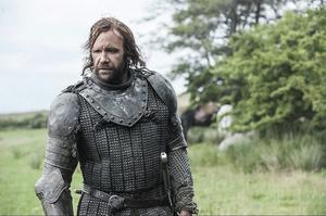 Game of Thrones The Hound strides the fields in heavy armour HBO