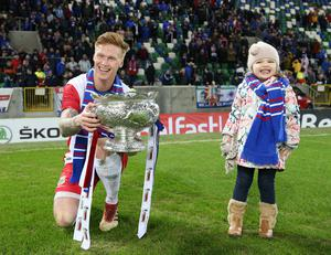 Prize and joy: Chris Casement celebrates Linfield's League Cup win with daughter Rose
