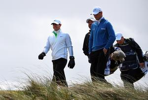 NEWCASTLE, NORTHERN IRELAND - MAY 29:  Rory McIlroy of Northern Ireland walks down the 2nd hole with Martin Kaymer during the Second Round of the Dubai Duty Free Irish Open Hosted by the Rory Foundation at Royal County Down Golf Club on May 29, 2015 in Newcastle, Northern Ireland.  (Photo by Ross Kinnaird/Getty Images)