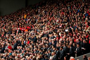 LIVERPOOL, ENGLAND - APRIL 15:  Fans, relatives and Liverpool FC staff and players during a memorial service to mark the 27th anniversary of the Hillsborough disaster, at Anfield stadium on April 15, 2016 in Liverpool, England. Thousands of fans, friends and relatives took part in the final Anfield memorial service for the 96 victims of the Hillsborough disaster. Earlier this year relatives of the victims agreed that this year's service would be the last. Bells across the City of Liverpool rung out during a one minute silence in memory of the 96 Liverpool supporters who lost their lives during a crush at an FA Cup semi-final match against Nottingham Forest at the Hillsborough football ground in Sheffield, South Yorkshire in 1989.  (Photo by Christopher Furlong/Getty Images)