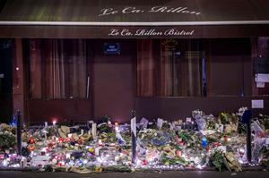The makeshift memorial in tribute to the victims of the Paris attacks  is pictured at night on November 15, 2015 at the Le Carillon cafe seen from Rue Alibert in the 10th arrondissement of the French capital.  Islamic State jihadists claimed a series of coordinated attacks by gunmen and suicide bombers in Paris on November 13 that killed at least 129 people in scenes of carnage at a concert hall, restaurants and the national stadium. AFP PHOTO /  LIONEL BONAVENTURELIONEL BONAVENTURE/AFP/Getty Images