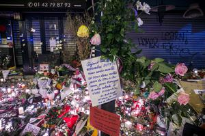 The makeshift memorial in tribute to the victims of the Paris attacks is pictured in the evening, on November 15, 2015 at the La Belle Equipe rue de Charonne, 11th arrondissement, of the French capital.  Islamic State jihadists claimed a series of coordinated attacks by gunmen and suicide bombers in Paris on November 13 that killed at least 130 people in scenes of carnage at a concert hall, restaurants and the national stadium. AFP PHOTO /  LIONEL BONAVENTURELIONEL BONAVENTURE/AFP/Getty Images