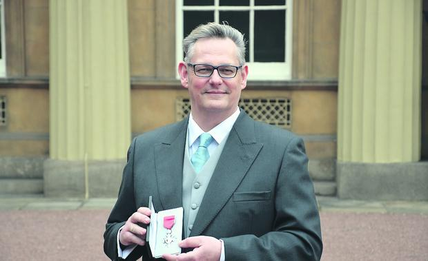 Artist Jasper McKinney after receiving the MBE