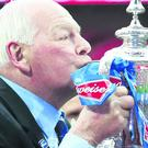 Wigan chairman Dave Whelan kisses the trophy following his team's 1-0 victory during the FA Cup with Budweiser Final between Manchester City and Wigan Athletic at Wembley Stadium on May 11, 2013 in London, England. (Photo by Alex Livesey/Getty Images)