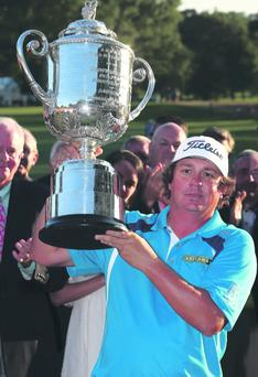 Jason Dufner of the United States poses with the Wanamaker Trophy after his two-stroke victory at the 95th PGA Championship