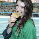 Bethany Firth, from Seaforde, Co. Down, celebrates with her gold medal after winning the women's 100m backstroke - S14. London 2012 Paralympic Games