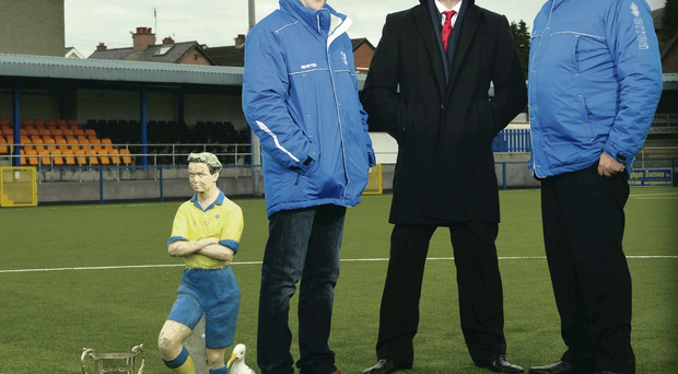 Gareth Scates, manager of Bangor FC; Harry McDaid, chief executive of UCIT; and Trevor Best, chairman of Bangor FC, celebrate the good news