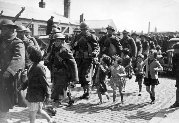 Dark days: US troops march from Belfast docks to LMS railway