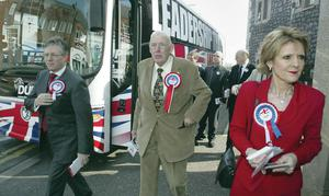 Canvassing together: Ian Paisley (centre), leader of the Democratic Unionists with deputy Peter Robinson (left) and his wife Iris Robinson as they embark on the election campaign in Carrickfergus, Co Antrim, Monday April 25, 2005.
