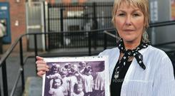Margaret McGuckin pictured today on the Springfield Road Belfast with people signing her partition about abuse and at care homes in Belfast Ormeau Road