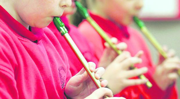 St Anne's Primary School pupils taking part in a music event. Their school could lose over £40,000 from its annual budget under new Department of Education proposals