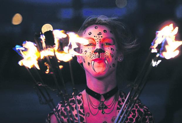 Flame-throwers entertain the crowds at the 2013 Halloween Monster Mash organised by Belfast City Council and Translink. ( Paul Moane/Aurora)