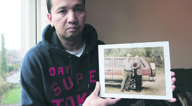 Rick Lapuz, of east Belfast, with a photo of his father, Rudy