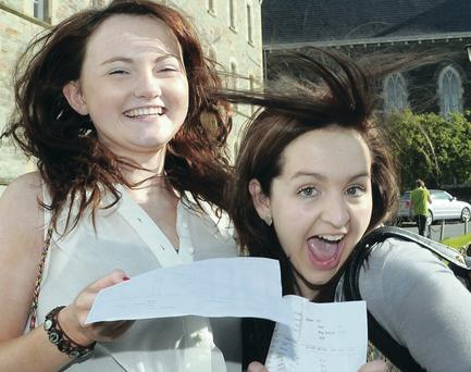 Aisling Barr, 6 A* and Clare Bowman. 10A* from Lumen Christie College in Derry who were celebrating after receiving their results . Picture Martin McKeown