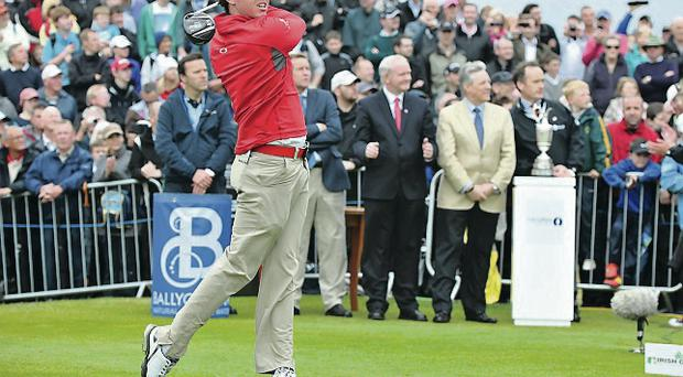 Rory McIlroy at the Irish Open at Royal Portrush in 2012, watched by Peter Robinson and Minister Martin McGuinness