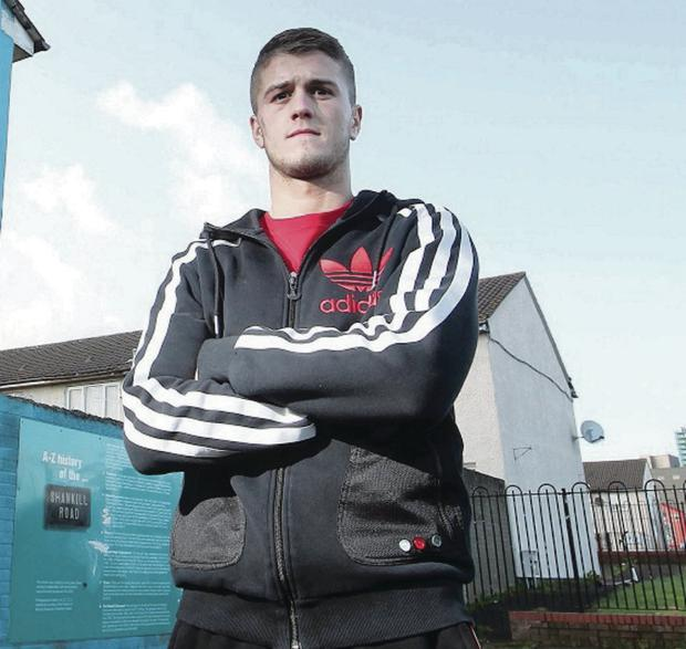 Boxer Marc McCullough pictured at his home on the Shankill estate in west Belfast.