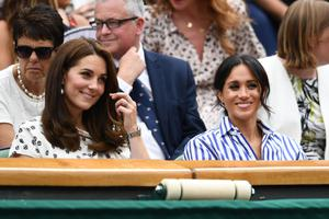 Close: Catherine, Duchess of Cambridge and Meghan, Duchess of Sussex attend Wimbledon in 2018