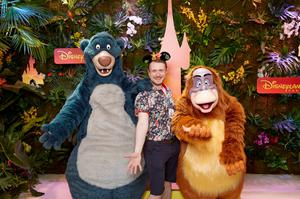 Warm welcome: Damon Smith celebrating with Baloo and King Louie at Disneyland Paris