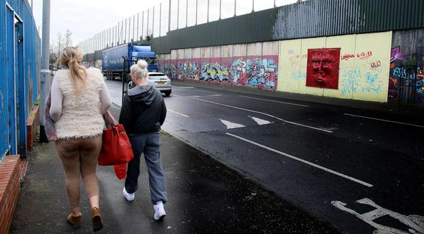 Still divided: the largest peace wall in Belfast at Cupar Way, which separates the Catholic Falls Road from the Protestant Shankill area