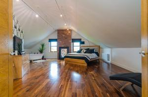 A walnut floor adds real warmth to this bedroom