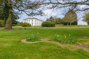 The estate covers 5 acres and features both formal and informal gardens