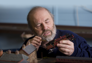 Expert eye: Derek Carter puts the finishing touches to one of his model carriages