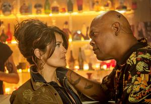 Screen partners: Salma Hayek and Samuel L Jackson lock lips as spouses in their new action movie
